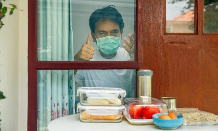 food-delivery-for-selfisolation-and-selfquarantine-to-help-stop-the-picture-id1212914228-696x421